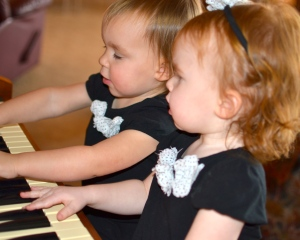 They look so sweet and innocent playing the organ, but this mama knows better...